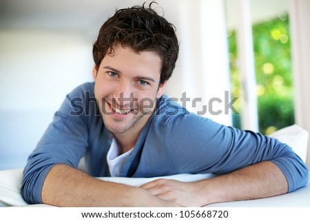 Closeup of attractive young man relaxing at home