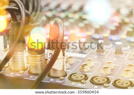 Closeup of audio connectors in sound mixed controller - stock photo