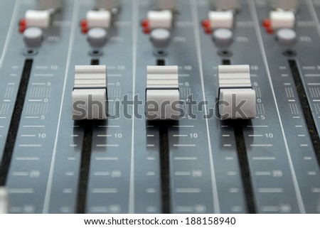 Closeup of audio mixing board
