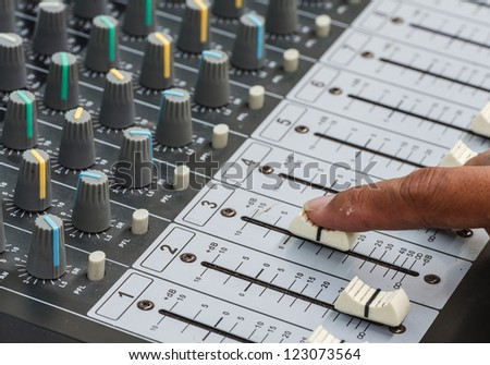 Closeup of audio mixing console. Shallow depth of field.