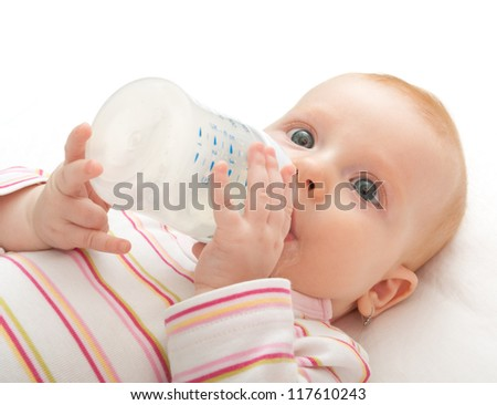 Closeup of Baby Girl Drinking Milk from Bottle