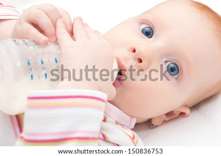 Closeup of Baby Girl Drinking Milk from Bottle - Shallow Depth of Field