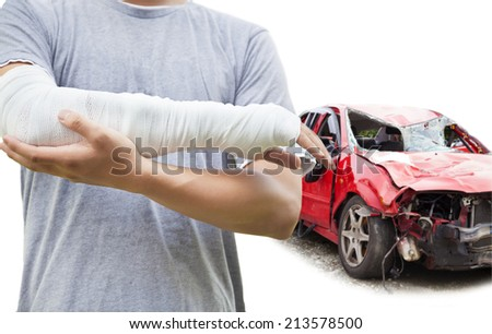 closeup of bandaged arm with blue wrecked car - stock photo