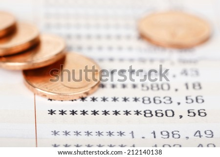 closeup of  bankbook with change, saving concept - stock photo