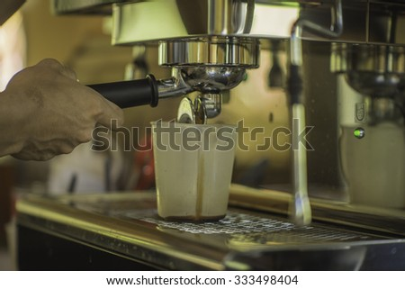 Closeup of barista grinding coffee