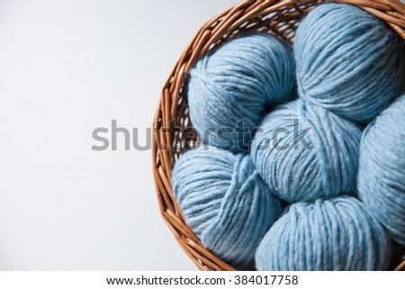Closeup of basket with colorful yarn clews.Concept of freelance creative working and happy living - stock photo