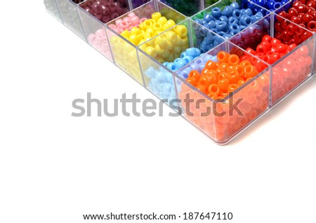 Closeup of beads in bins separated for making crafts jewelry - stock photo