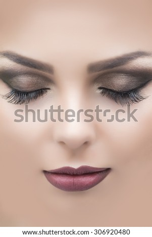 Closeup of beautiful attractive sensual female face with soft dark red or vinous lips brown closed eyes and long eyelashes of young sleeping beauty woman, vertical picture - stock photo