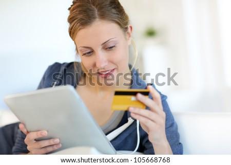 Closeup of beautiful blond girl doing online shopping - stock photo