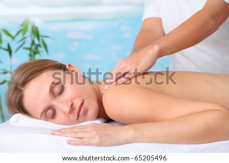 Closeup of beautiful blond woman on a massage bed - stock photo