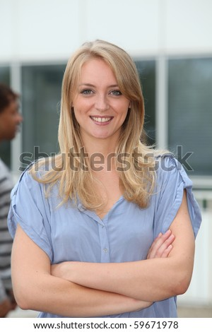 Closeup of beautiful blond woman with arms crossed