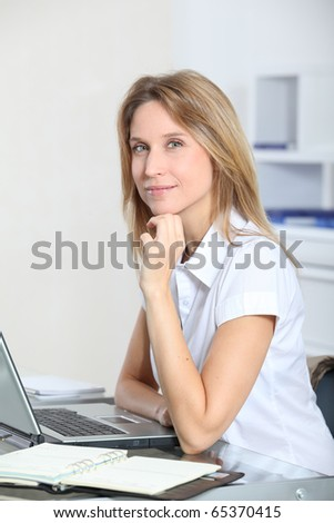 Closeup of beautiful businesswoman in the office - stock photo