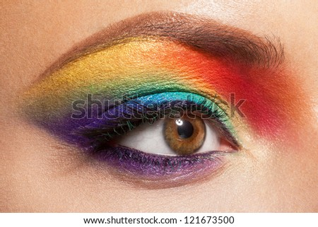closeup of beautiful female eye with rainbow makeup - stock photo