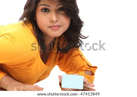 Closeup of beautiful girl with blue blank credit card - stock photo
