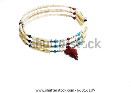 Closeup of beautiful handcrafted bone and bead Native American Necklace against white background. - stock photo