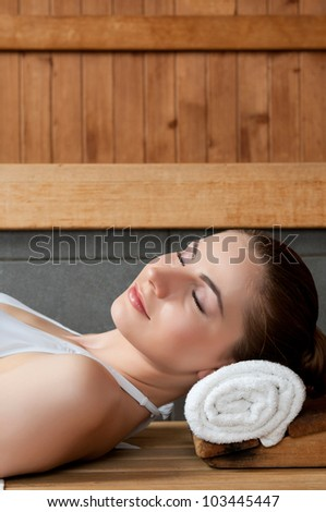 Closeup of beautiful lady relaxing at sauna in a spa center