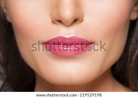 Closeup of beautiful sexy lips with pink lipstick  - stock photo