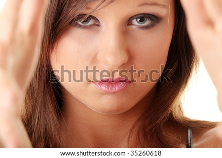 Closeup of beautiful teen making frame with her hands