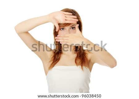 Closeup of beautiful teen woman making frame on her face with her hands - stock photo