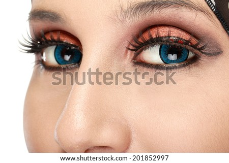 Closeup of beautiful woman eye with makeup. woman with scarf