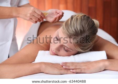 Closeup of beautiful woman laying on a massage bed - stock photo