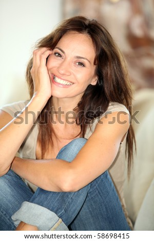 Closeup of beautiful woman relaxing at home - stock photo