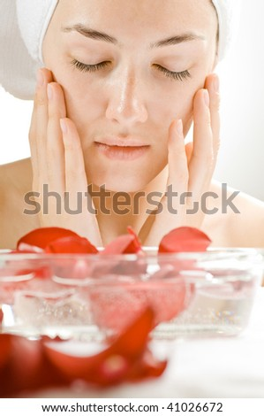 closeup of beauty woman  with spa flowers