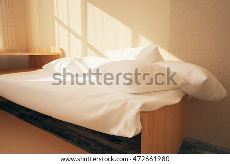 Closeup of bed with white pillows in interior with concrete wall and wooden floor. 3D Rendering