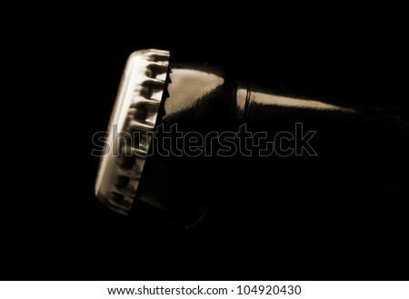 closeup of beer bottle on black background - stock photo