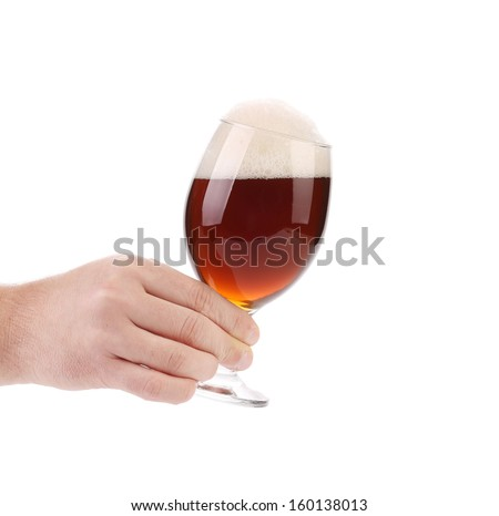 Closeup of beer glass in hand. Isolated on a white background.