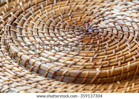Closeup of beige basket. Wicker woven pattern for abstract background or texture. Circle, selective focus - stock photo