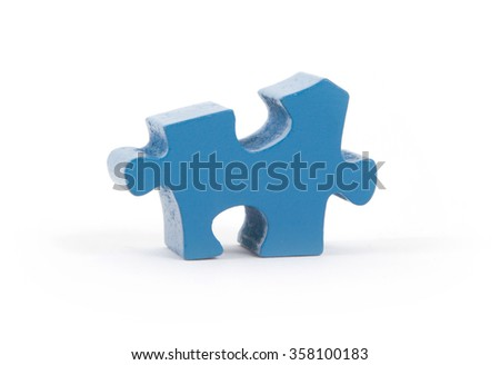 Closeup of big blue jigsaw puzzle piece isolated on white