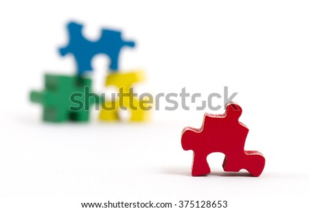 Closeup of big jigsaw puzzle piece isolated on white, perspective