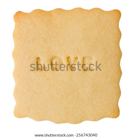 Closeup of biscuit with LOVE sign isolated on white background. Love cookie - stock photo