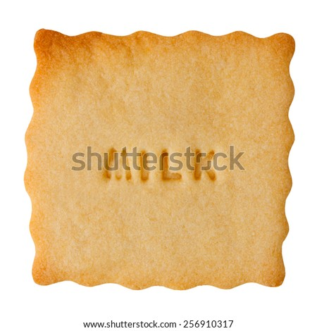 Closeup of biscuit with MILK sign isolated on white background.