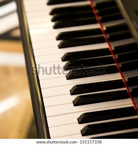 Closeup of black and white piano keys. - stock photo