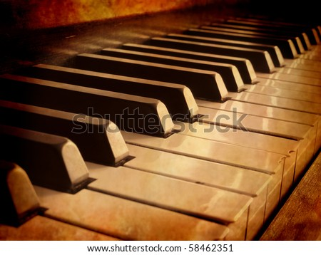 Closeup of black and white piano keys and wood grain with sepia tone - stock photo