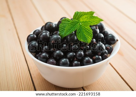 closeup of black currant on table - stock photo
