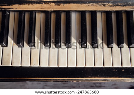 closeup of blacks and white keys of a vintage piano classical - stock photo