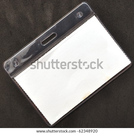 closeup of blank badge on black background - stock photo