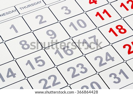 closeup of blank calendar with grey and red numbers
