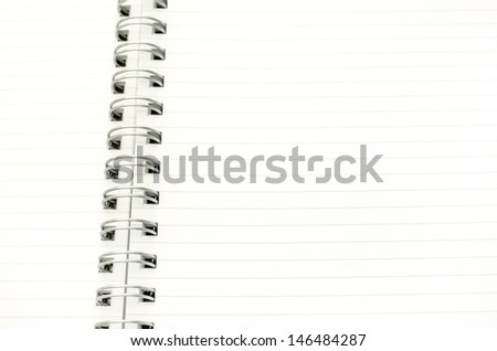 Closeup of blank spiral notebook. Empty space ready for your text or logo.
