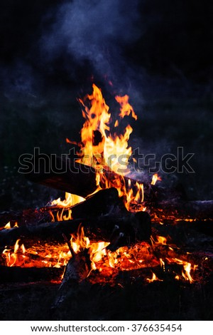 Closeup of blazing campfire coals in the night