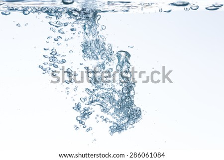 Closeup of blue bubbles underwater