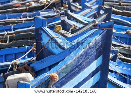 Closeup of blue fishing boats in Essaouira, Morocco. - stock photo