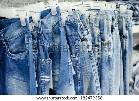 closeup of blue jeans in a shop - stock photo