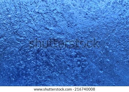 Closeup of blue natural ice texture - stock photo