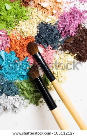 Closeup of blush and multicolor crushed eye-shadows on white background