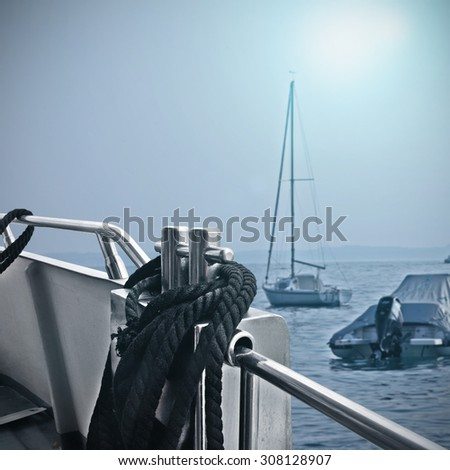 closeup of boat and water of sea with sun