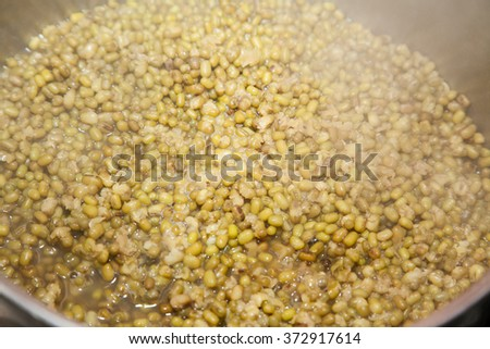 Closeup of boiling green mung beans - stock photo